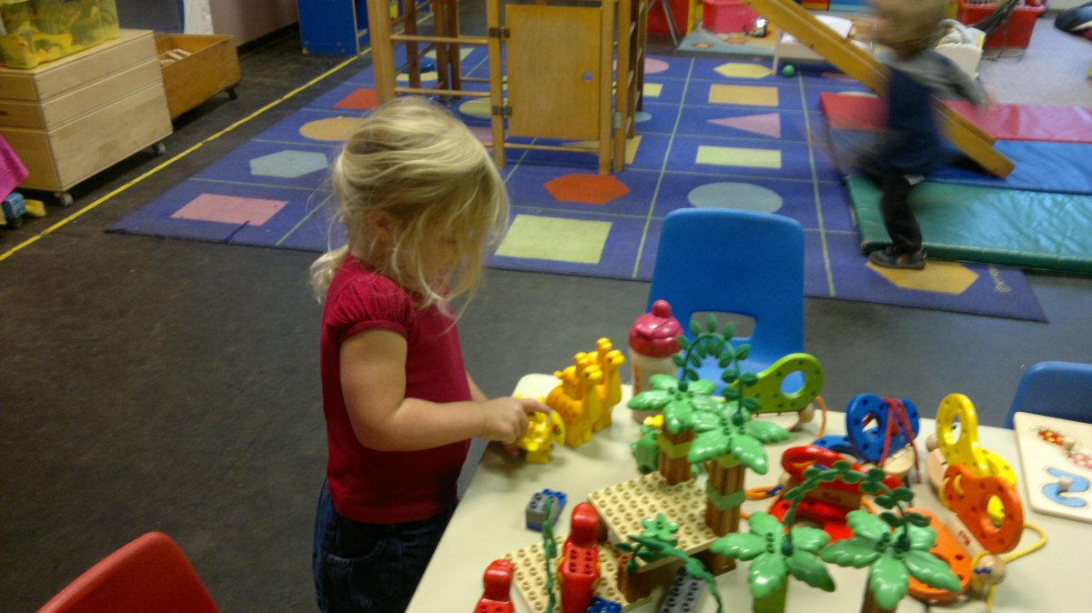 child playing at olive shapley playgroup in didsbury